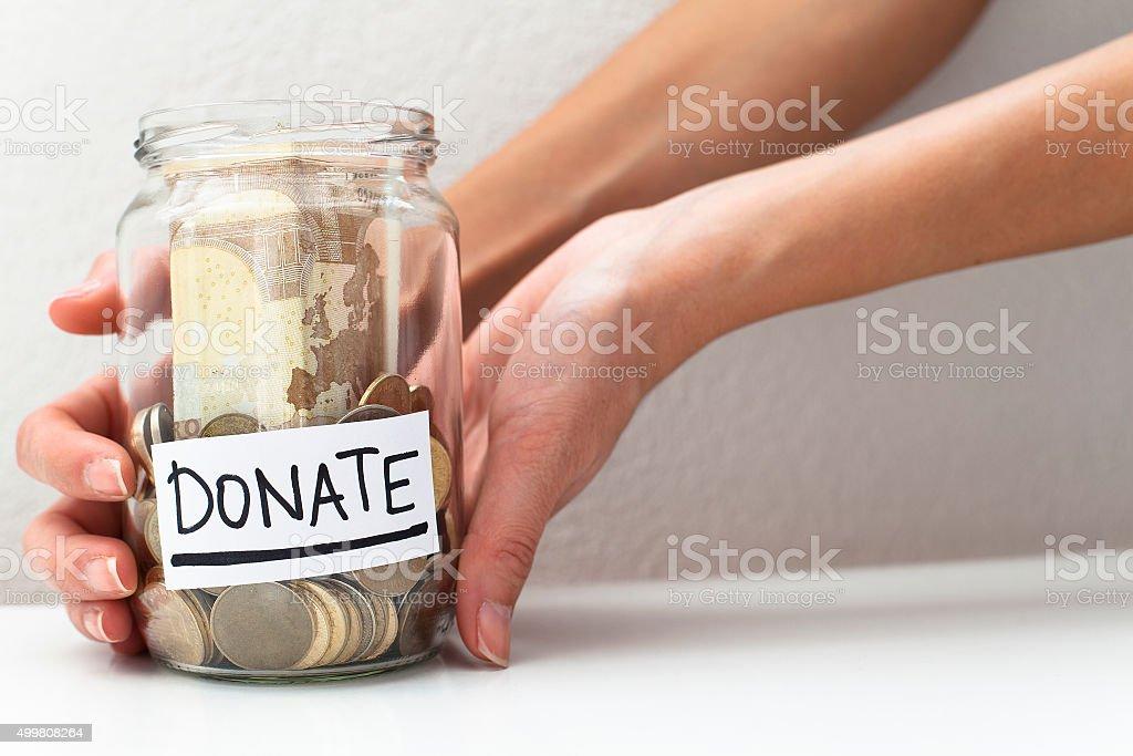 Donate Donation Money Jar stock photo
