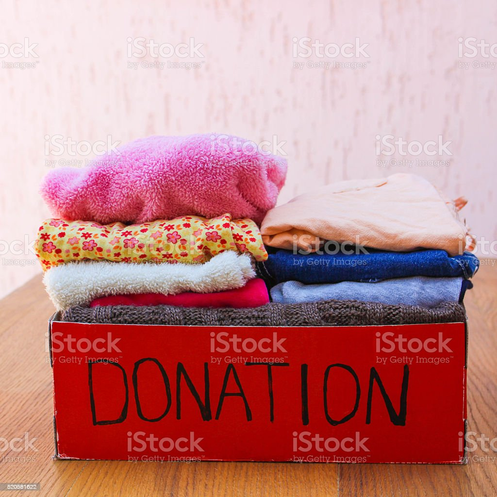 Donation box with clothes stock photo