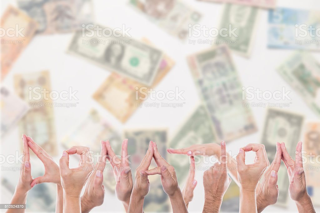 donation in front of different currencies stock photo