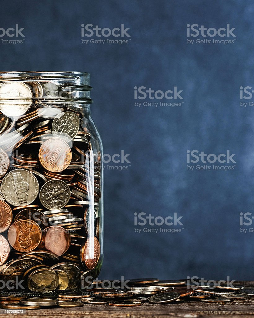 Donation Jar Against Blank Blackboard royalty-free stock photo