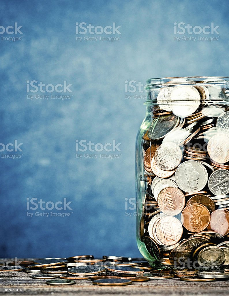 Donation Jar Against Blank Blackboard stock photo