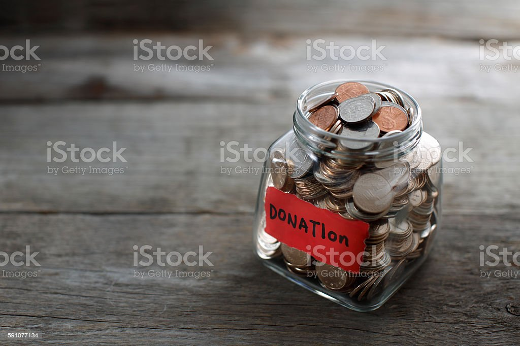 Donation Jar  on wooden table stock photo