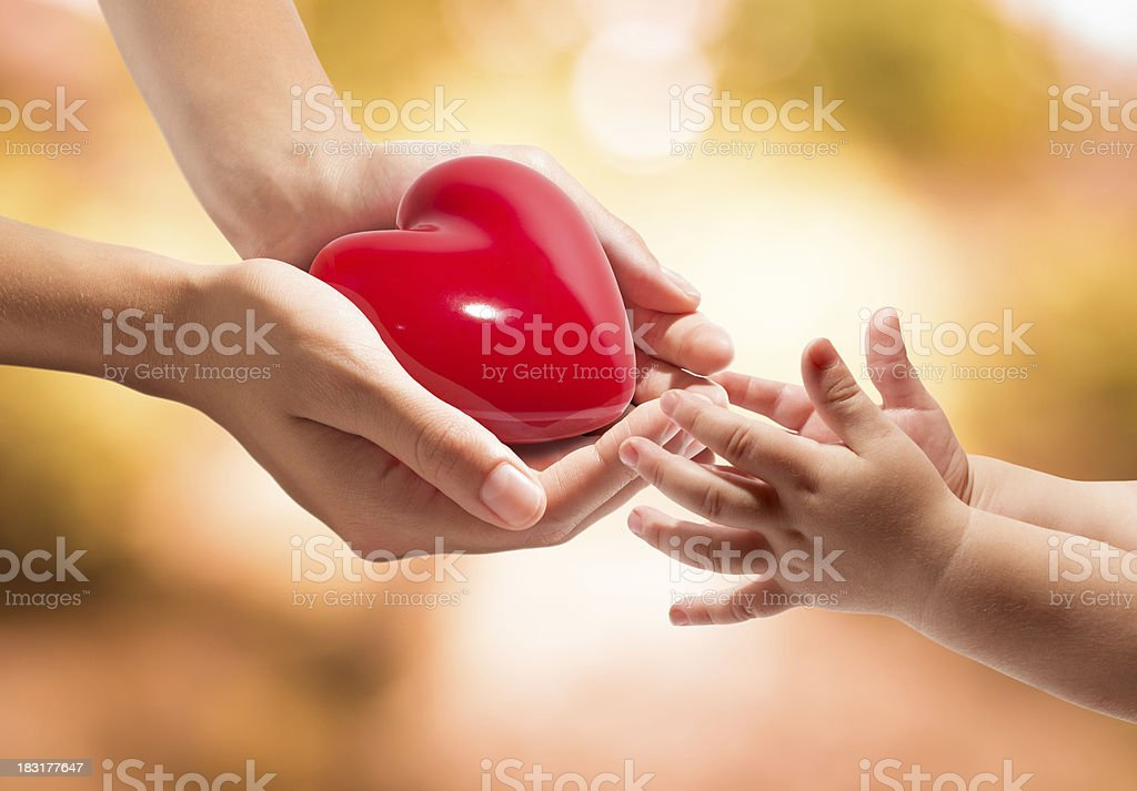 donation of life - give a heart to baby stock photo