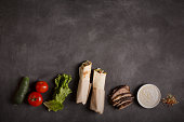 Doner kebab - fried beef meat with vegetables. Copy space
