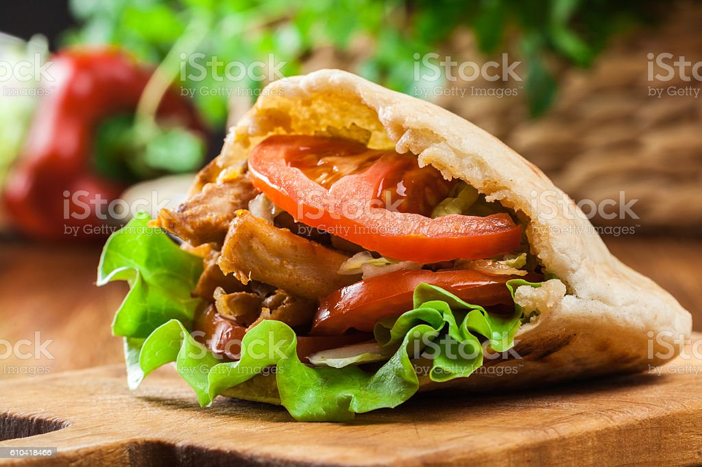 Doner kebab - fried chicken meat with vegetables stock photo