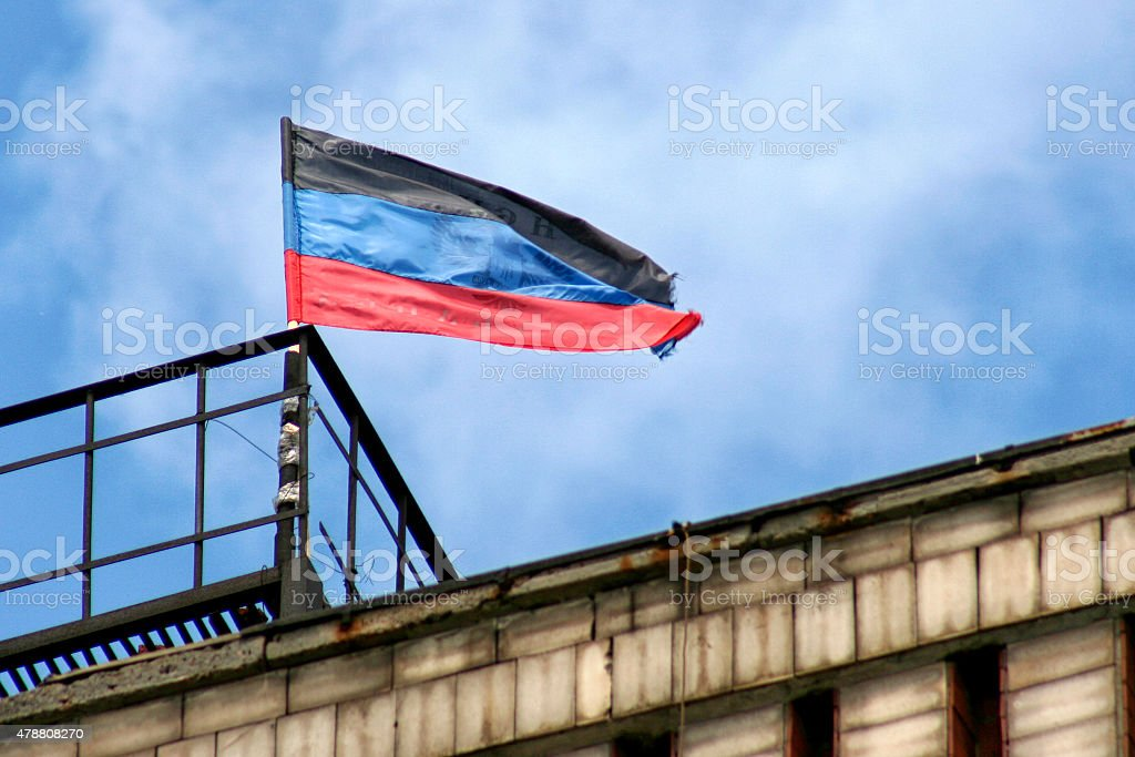 Donetsk Republic  Flags on background the sky stock photo