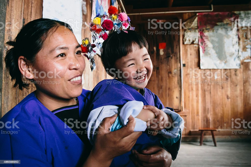 Dong People Happy Mother and Daughter in their Home, China stock photo