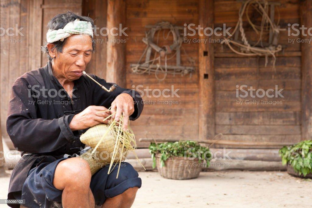 Dong Tribe Farmer Making Fishing Basket royalty-free stock photo