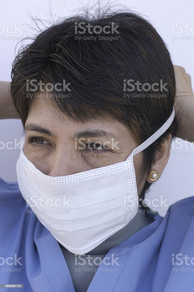 donning a surgical mask royalty-free stock photo