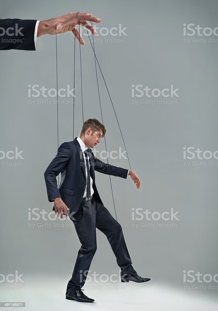 Don't become a corporate puppet stock photo