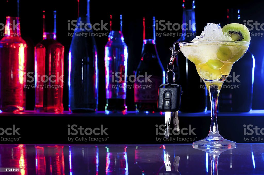 Don't drive after drink, car keys and the cocktail glass royalty-free stock photo