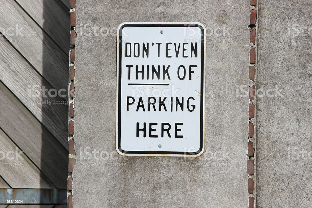 don't even think of parking here sign stock photo