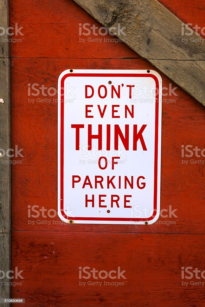 Don't Ever Think of Parking Here sign stock photo