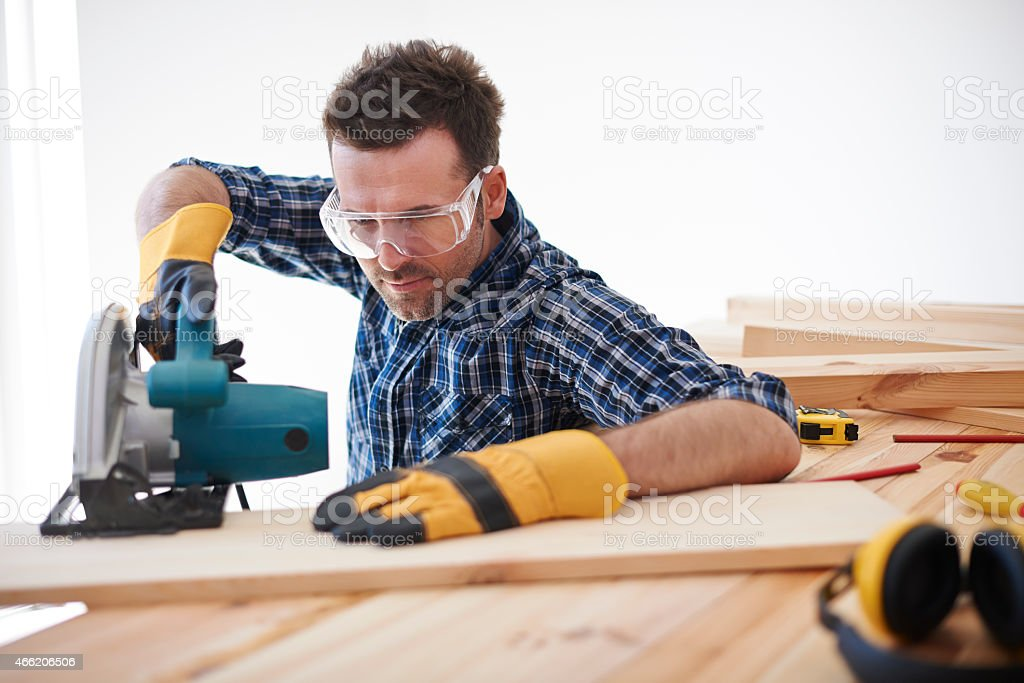Don't forget about safety when you use electric saw stock photo