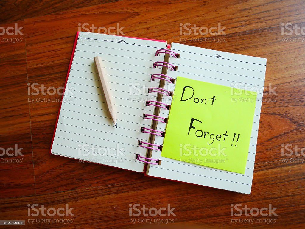 Don't forget post it on table stock photo