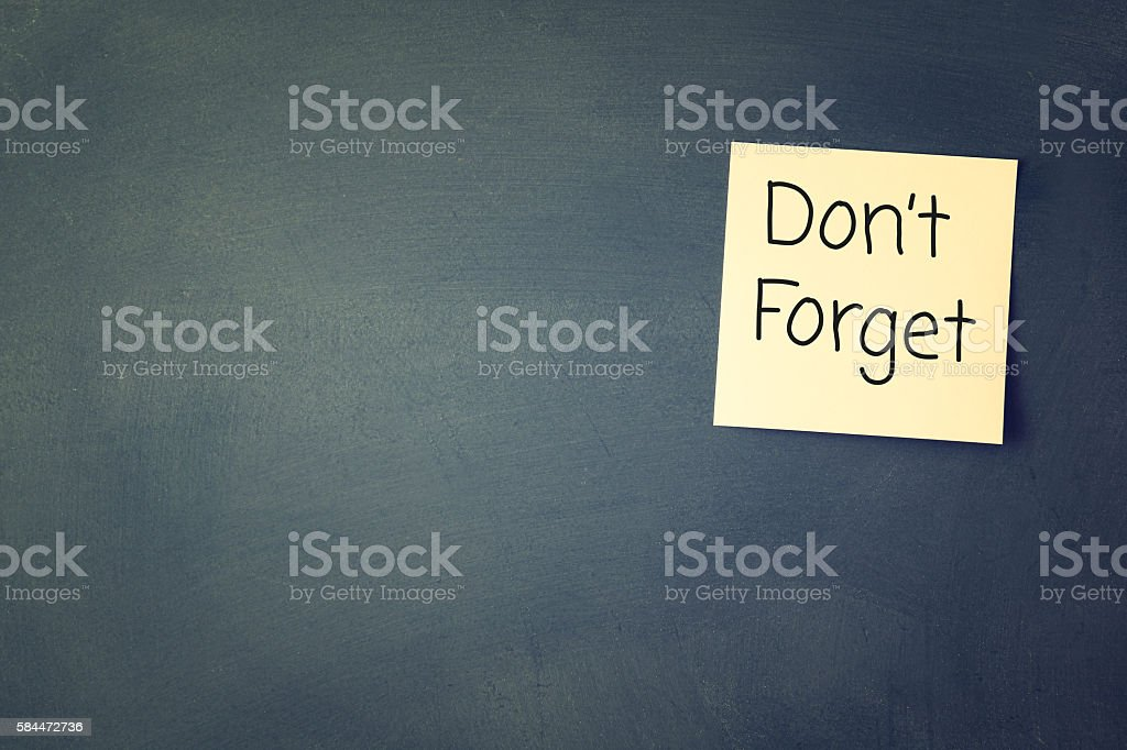 don't forget reminder, written on sticky memo stock photo