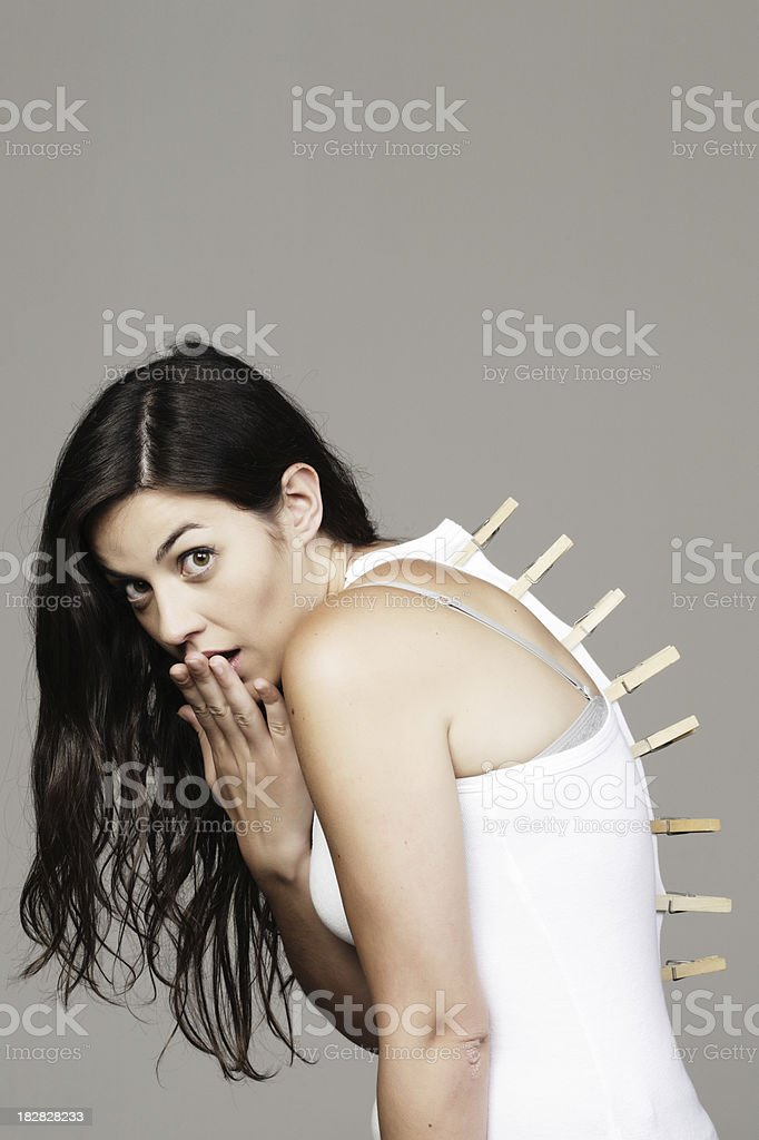 Don't forget to remove your clothespins girl _  Vertical royalty-free stock photo