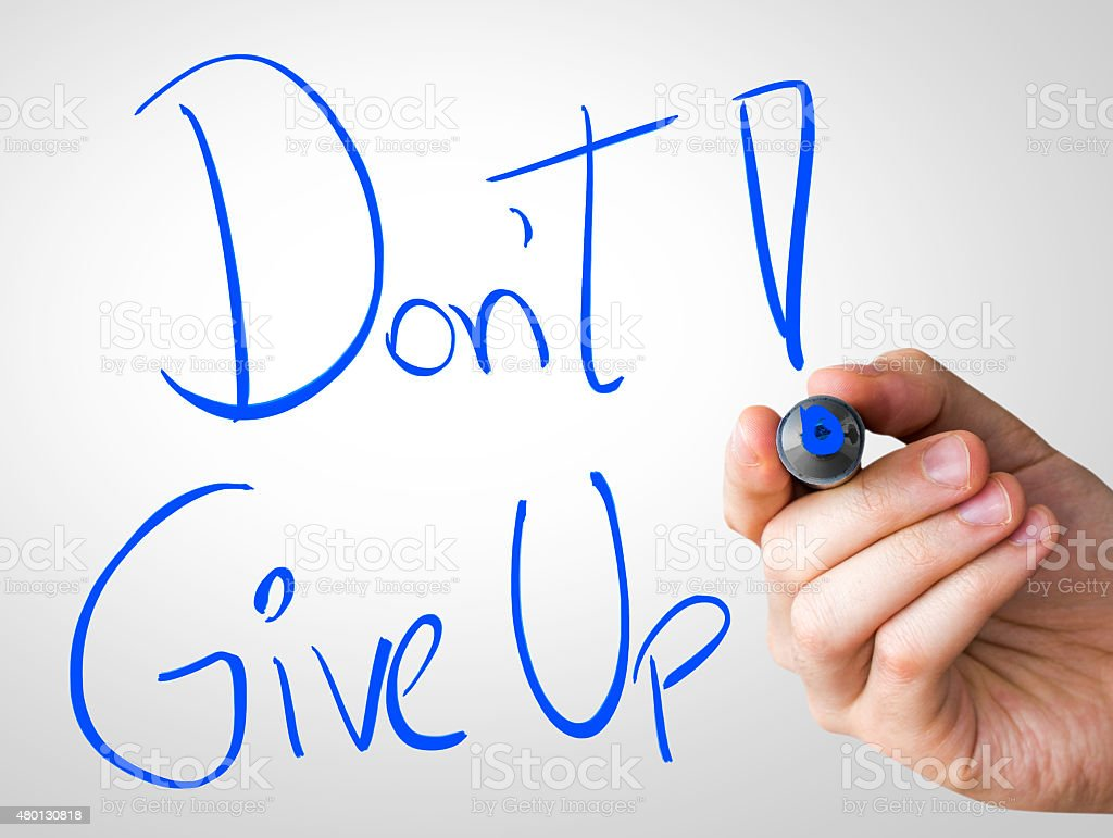 Don't Give Up written on the Wipe board stock photo