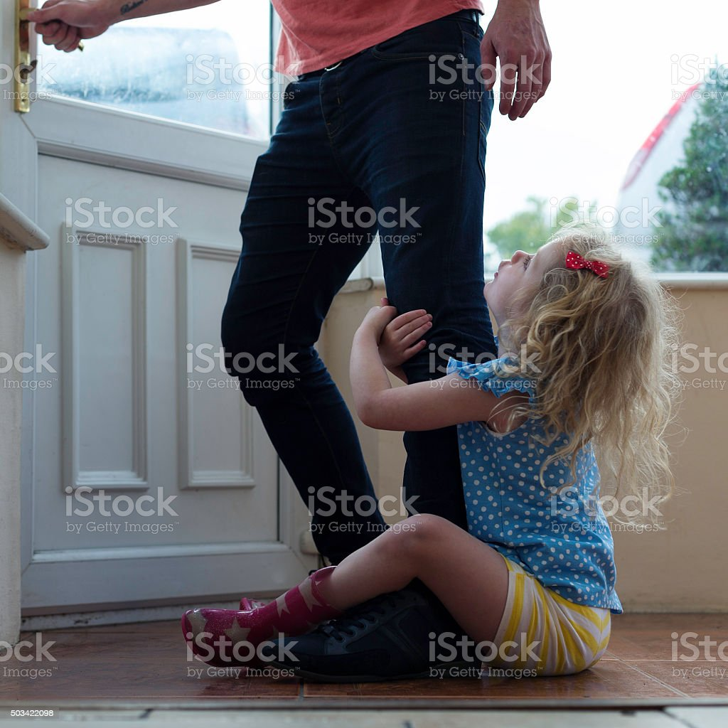 Don't go dad! stock photo