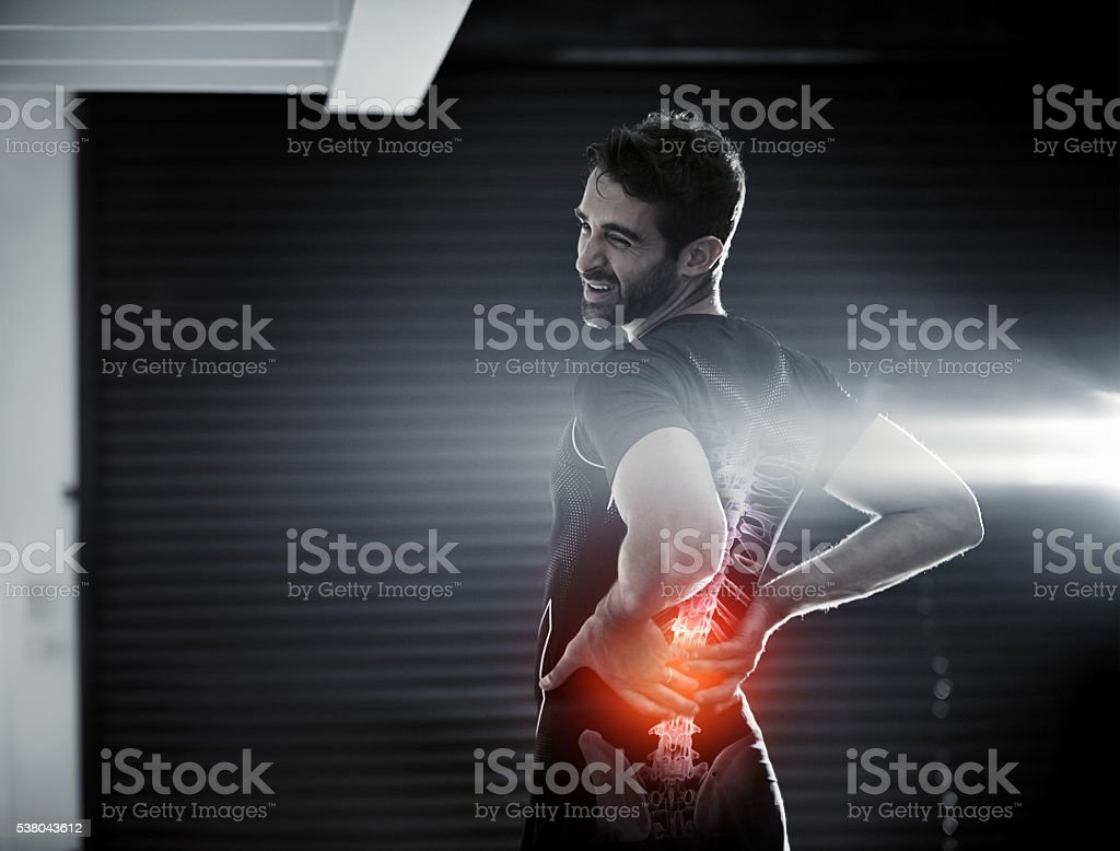 Don't let your back injury get you down stock photo