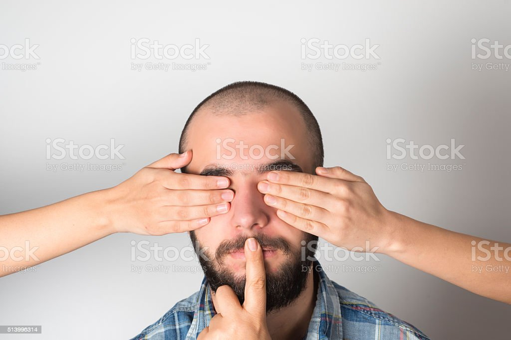 Don't look, don't talk stock photo