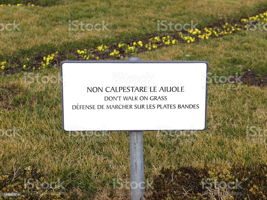 Don't walk on the grass royalty-free stock photo