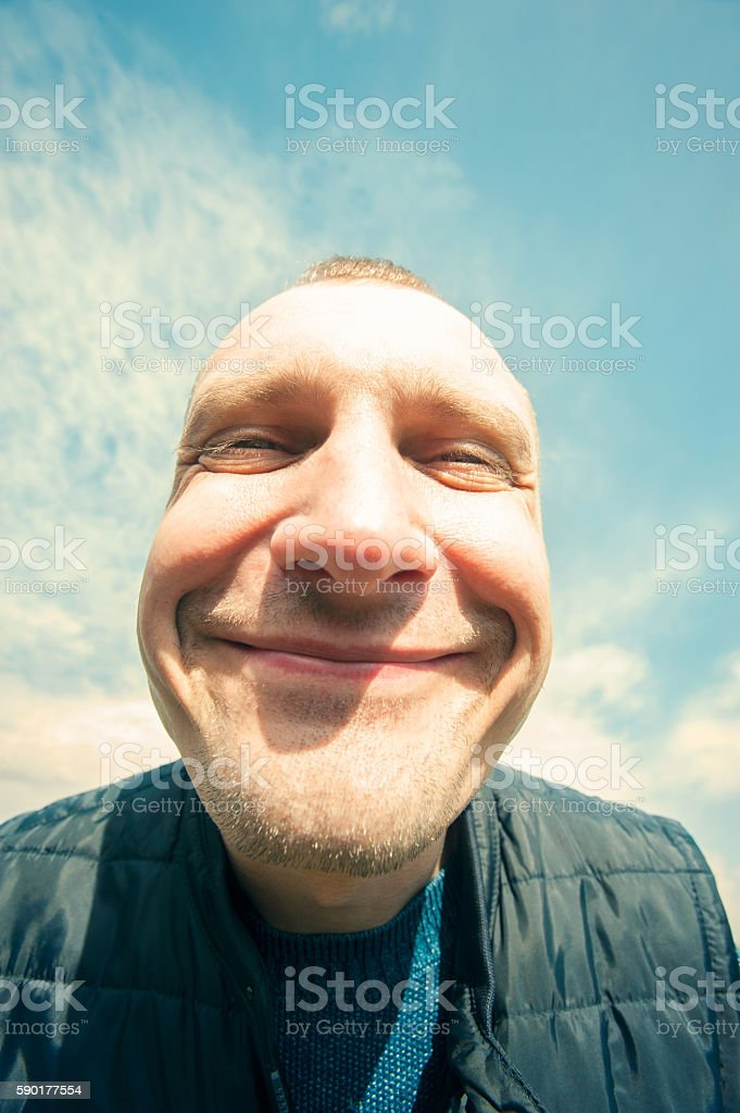 Don't worry-be happy! Delighted funny man closeup portrait. stock photo