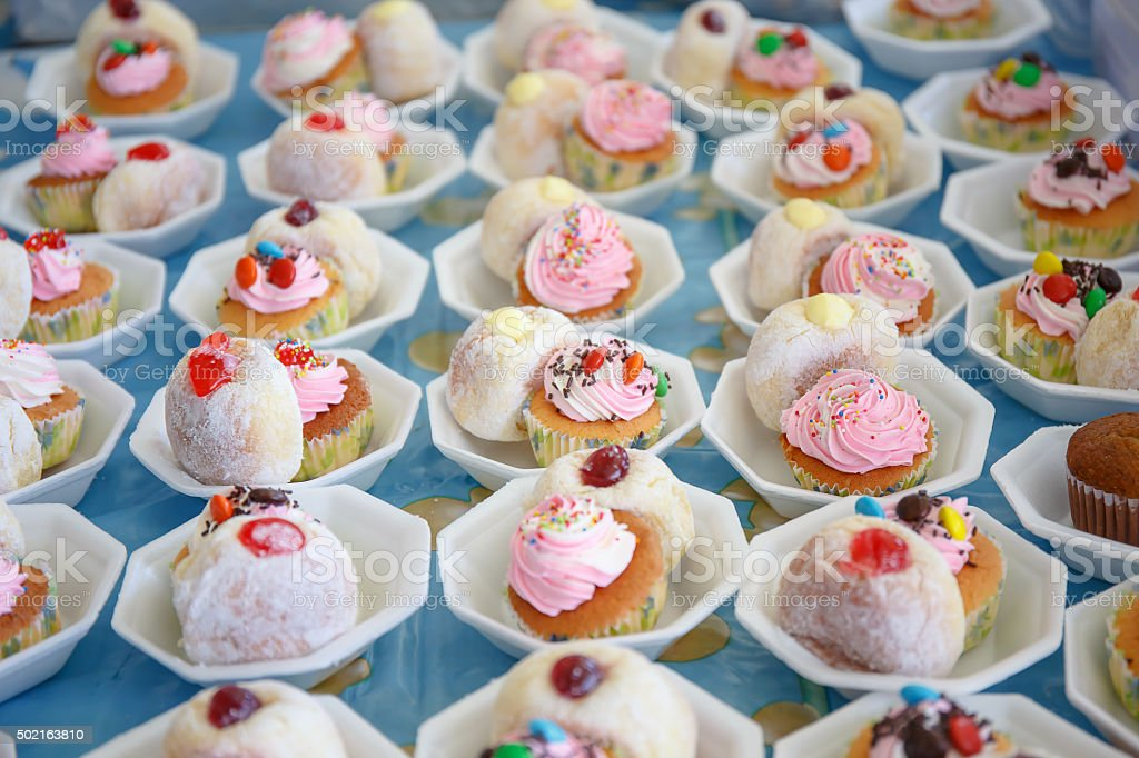 Donut and cup cake on table stock photo