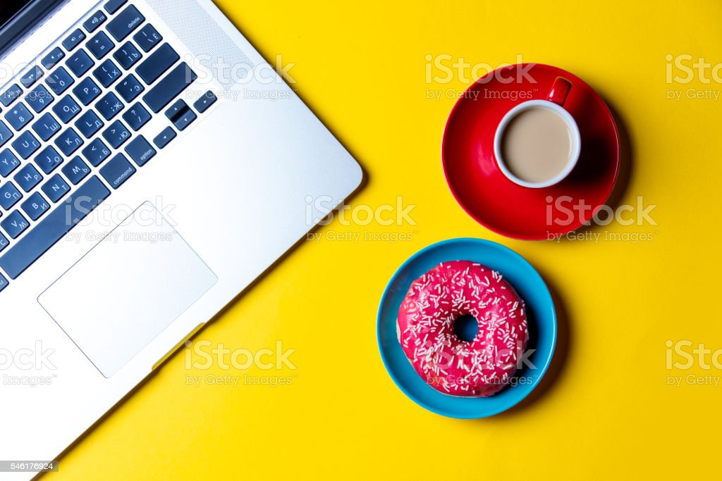 donut, cup of coffee and laptop stock photo