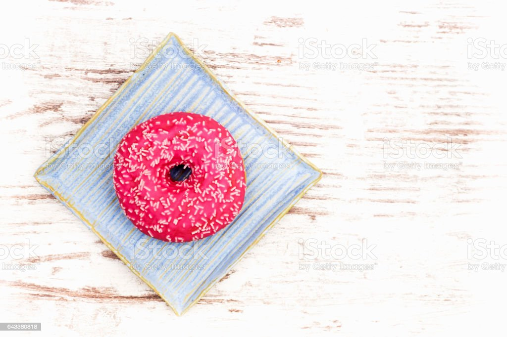Donut on white wooden table stock photo