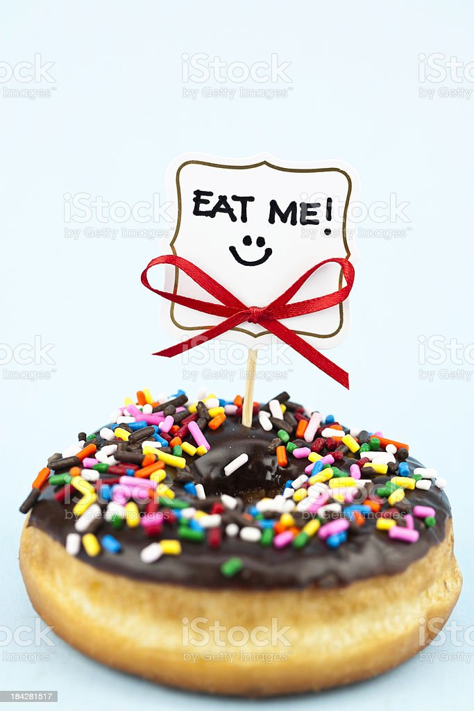 Donut with Eat Me Sign royalty-free stock photo