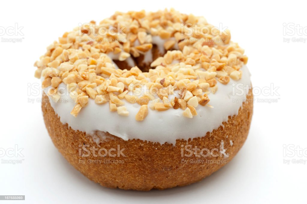 donut with icing and crushed peanuts stock photo