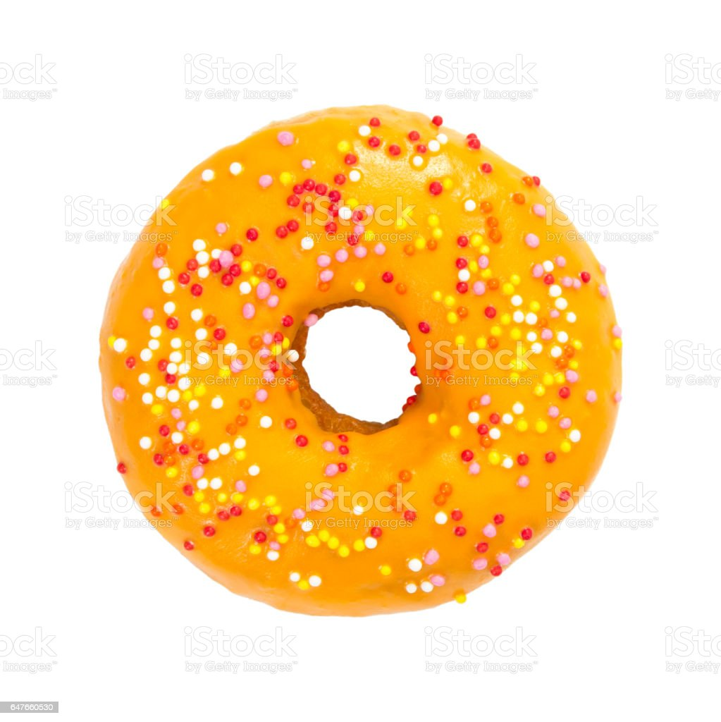Donut with orange glaze and colorful sprinkles stock photo
