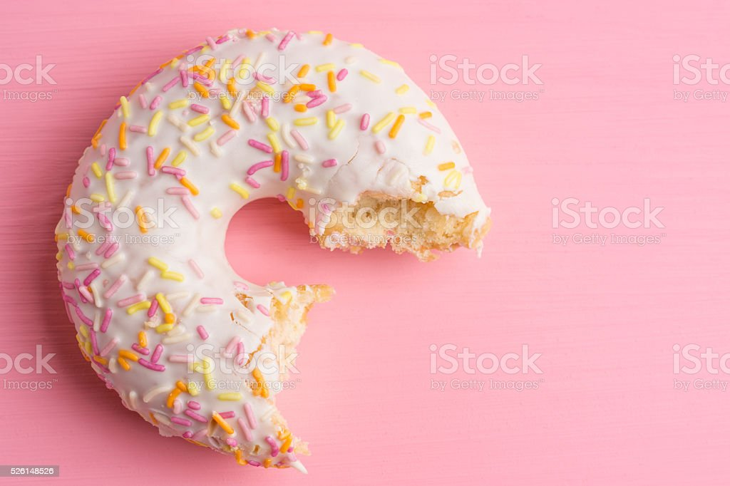 Donut with sprinkles stock photo