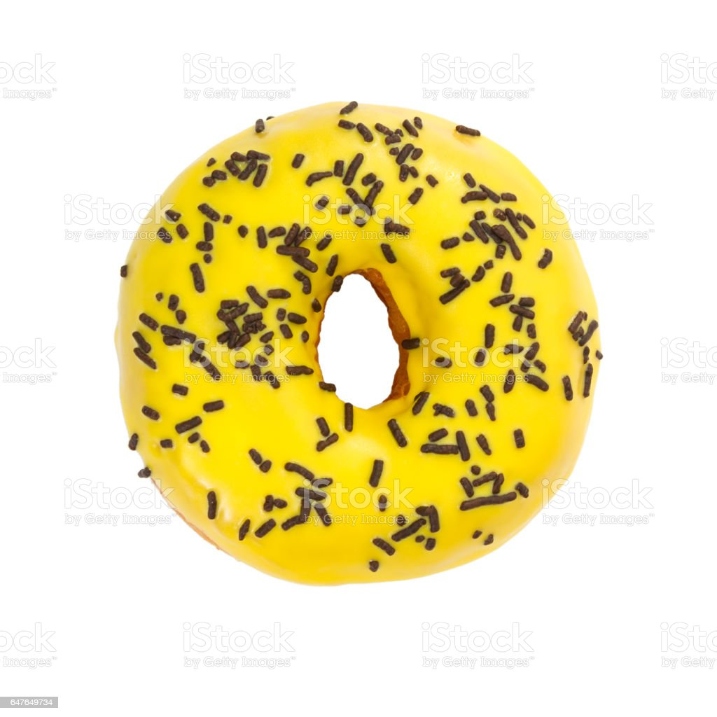 Donut with yellow glaze and chocolate sprinkles stock photo