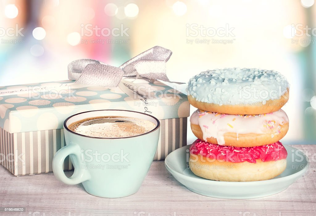Donuts and coffee cup on colordul retro background. stock photo