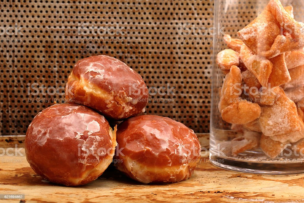 Donuts and faworki. Traditional Polish cookies on Fat Thursday stock photo