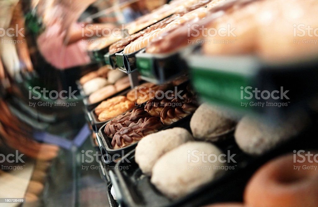 Donuts arranged in a window display royalty-free stock photo