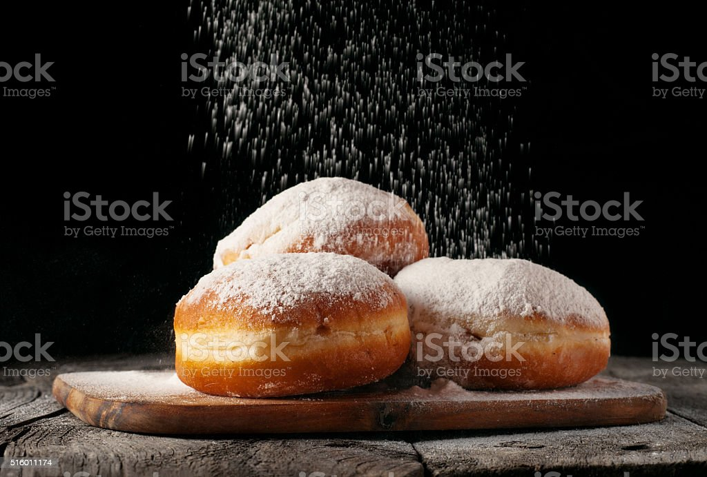 Donuts sprinkled with powdered sugar stock photo