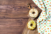Donuts with nuts on wooden background