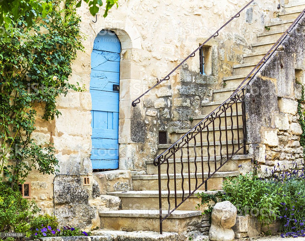 Door and stone steps of old Provencal house stock photo