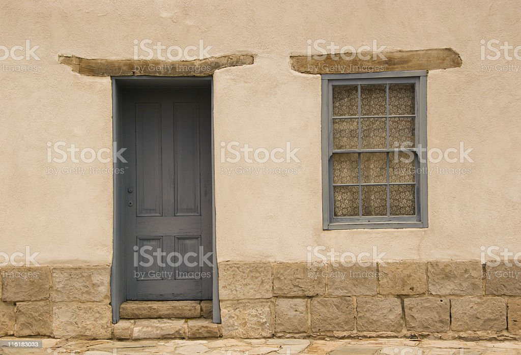 Door and Window in Adobe Wall, Southwest Style Architecture, Rough-Hewn royalty-free stock photo