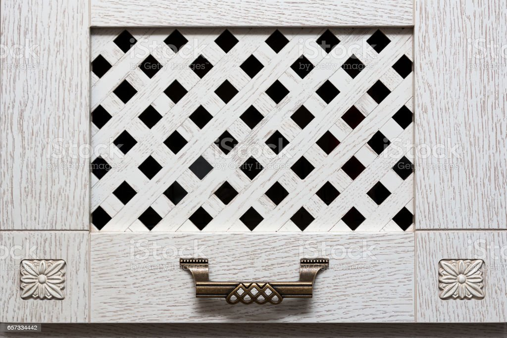 door cabinet with light wooden bars and metal handle in ancient style stock photo