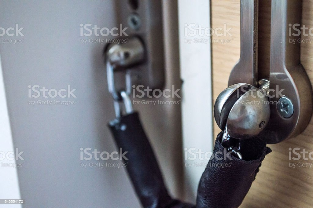 Door Chain/Lock on a Wooden Door Close Up royalty-free stock photo
