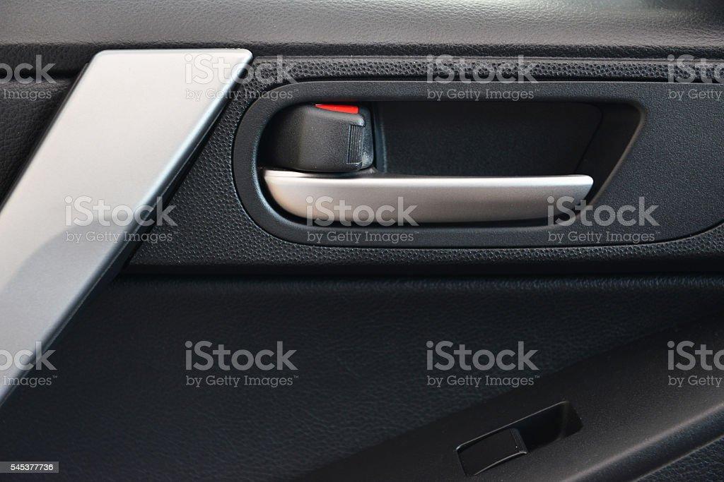 Door handle inside the car. stock photo