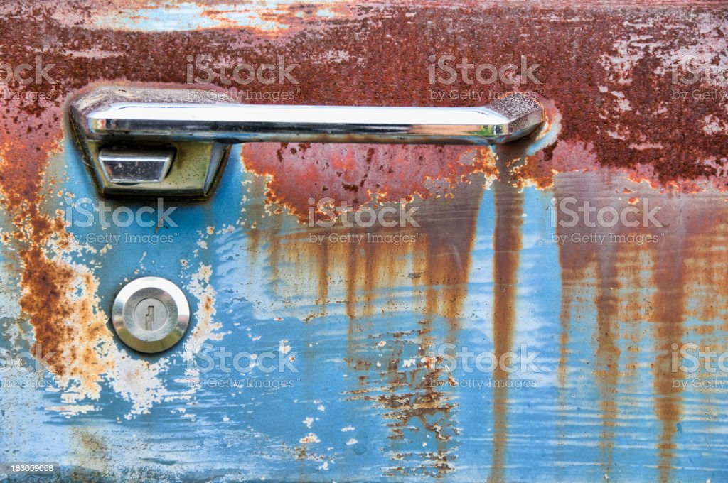Door handle of an abandoned car royalty-free stock photo
