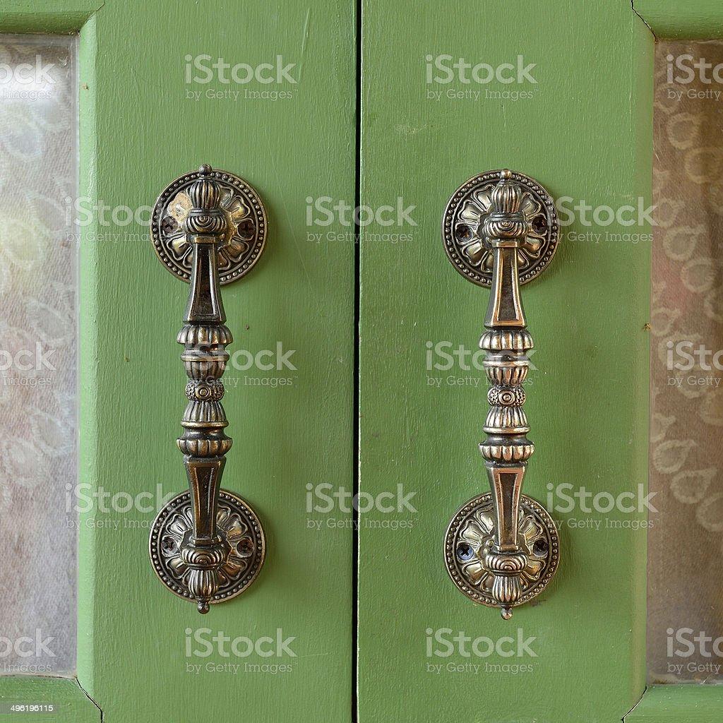Door handle on wooden door royalty-free stock photo