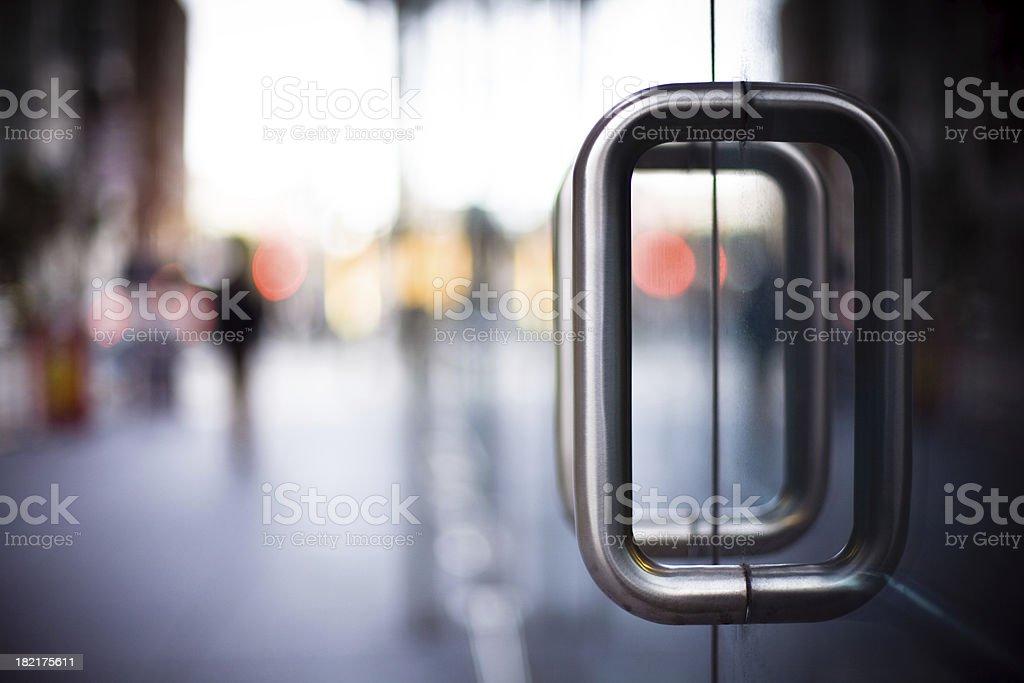 Door Handles on a Glass Office Building stock photo