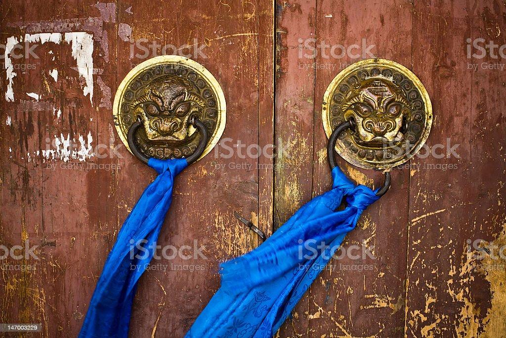 Door handles on ancient temple royalty-free stock photo