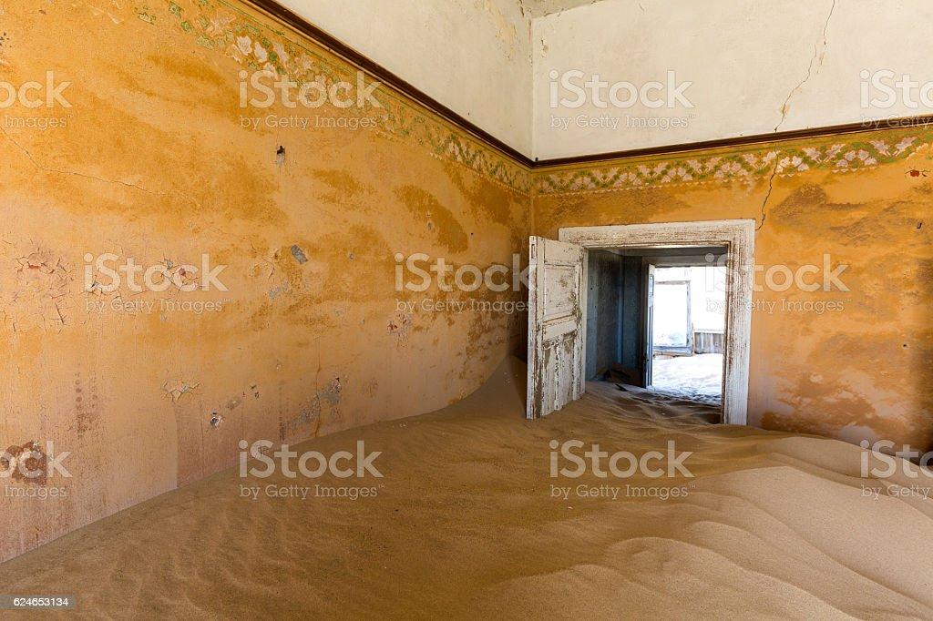 Door held open by sand stock photo